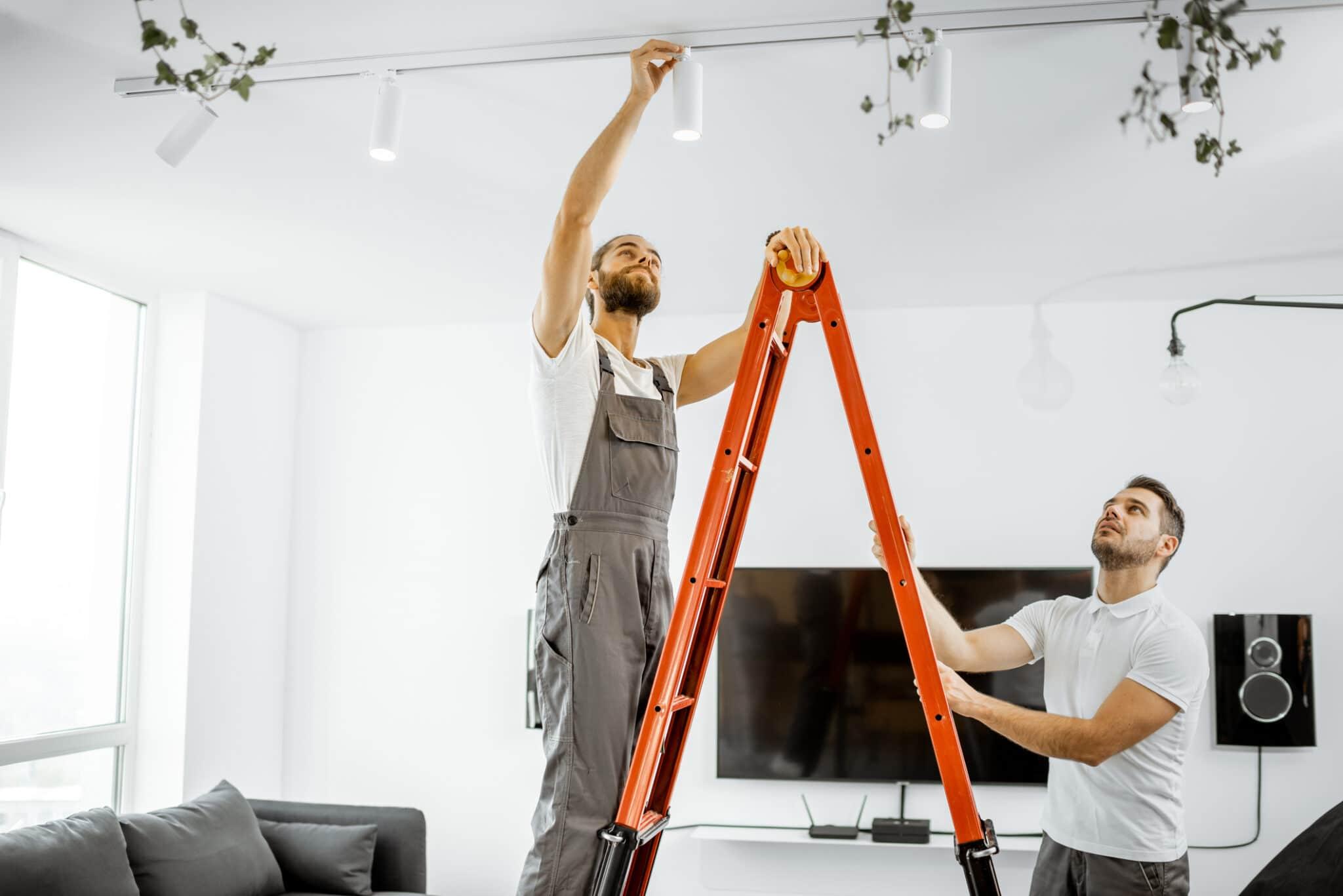 Men installing lights at home